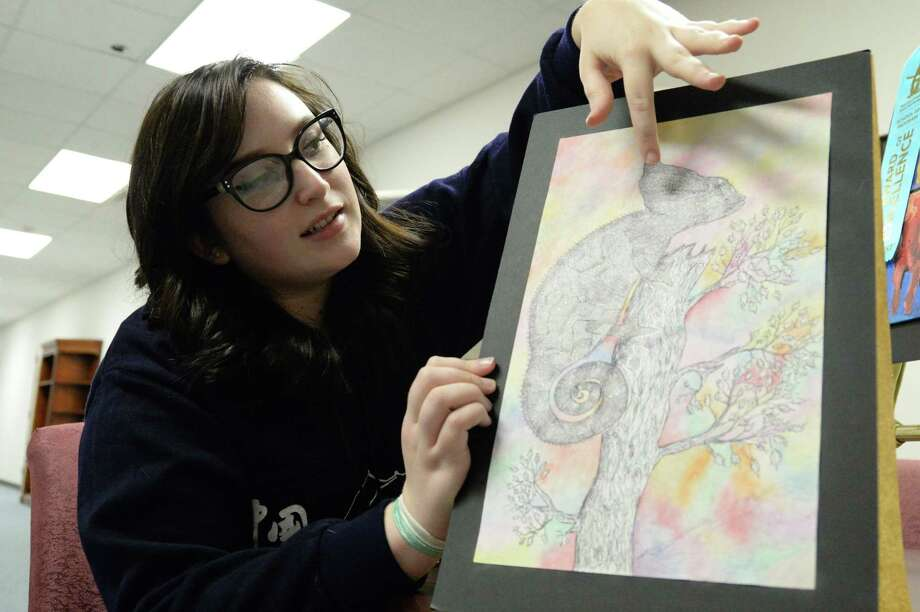 La Porte High School junior Brittany McWhorter was among six students whose art was selected to represent La Porte ISD at the Houston Livestock Show and Rodeo in March. One of her pieces, a watercolor showing a cow skull with flowers growing from the eye sockets, was a best-in-show winner for the district at the high school level and will be displayed at NRG Arena. Photo: Y.C. Orozco / Houston Chronicle