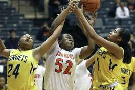 Brandeis' Breauna Delon battles East Central's Brittany Rodgers (left) and Ryan Gonzalez in their first-round playoff.