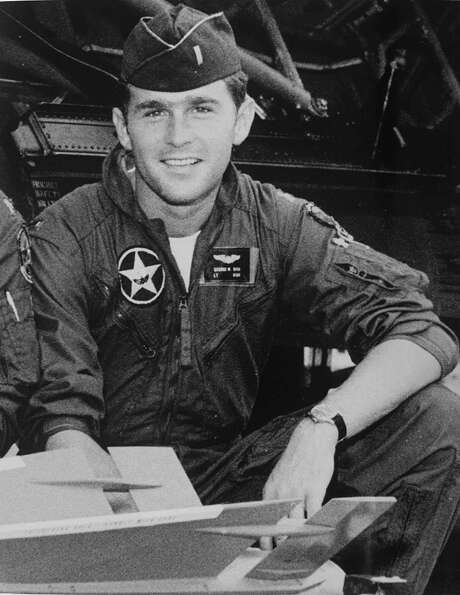 FILE -- George W. Bush is shown in this undated file photo when he was a pilot in the Texas Air National Guard. Whether former President Bush helped his son get into the Guard to avoid Vietnam has been an ongoing controversy. The younger Bush maintains there was no undue influence. (AP Photo/George Bush Presidential Library, File) Photo: ST / AP
