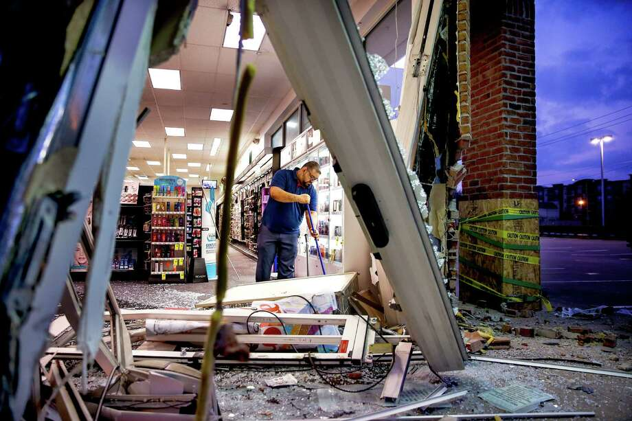 Robbers hit two drug stores in two daysCVS store manager Erick Castillo cleans up after two people crashed a stolen truck into the store off Waugh Drive and West Dallas Street as they attempted to steal the ATM Monday, Feb. 13, 2017 in Houston. A second store was hit the next day. Photo: Michael Ciaglo, Houston Chronicle / Michael Ciaglo