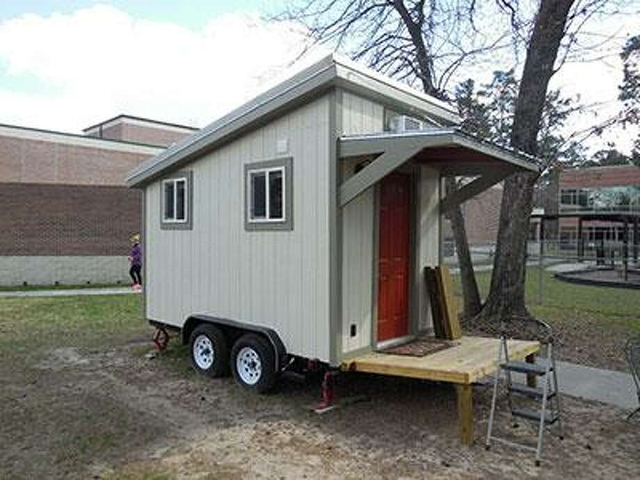 LSC-Kingwood students, employees and community members built this tiny house as temporary shelter for homeless individuals in the area. The house will be donated to a local church and managed by Family Promise Lake Houston. Photo: Courtesy Photo / Courtesy Photo