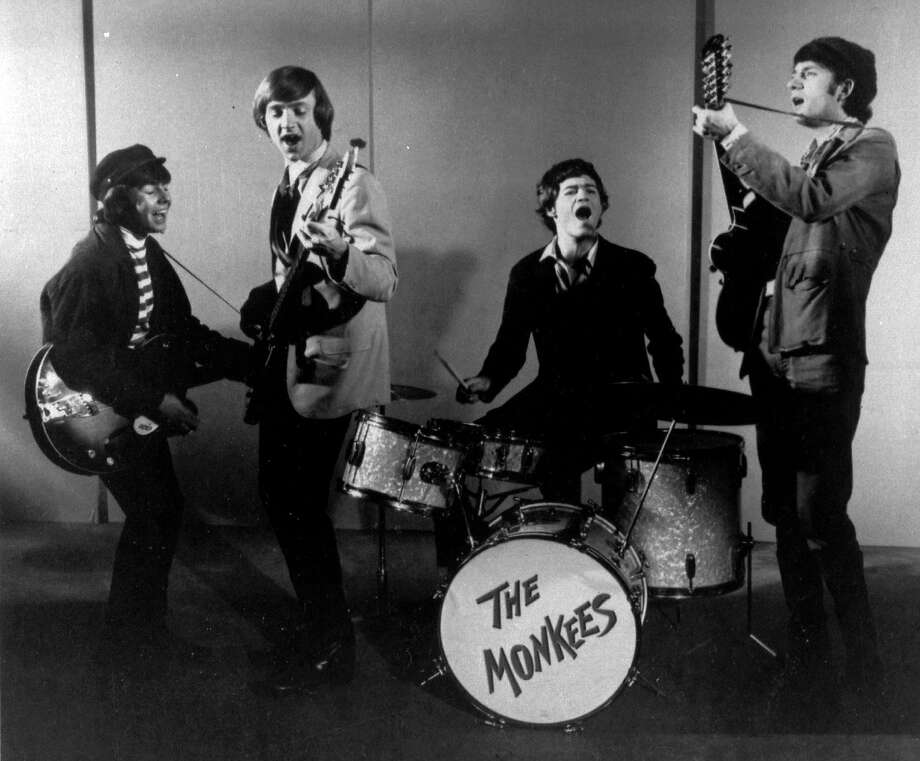 Peter Tork is seen playing bass alongside fellow Monkees Davy Jones (left), Micky Dolenz and Mike Nesmith. Photo: Associated Press 1966