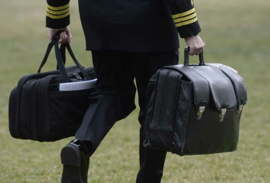 A military aide carries the nuclear football as he prepare to travel with U.S. President Donald Trump on Marine One on Feb. 3, 2017 in Washington, D.C. Photo by Olivier Douliery/Abaca Press/TNS) Photo: Olivier Douliery, MBR / TNS / Abaca Press
