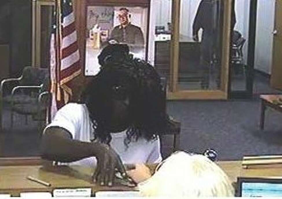 Thomas T. Smith, disguised in a wig, robs an Albany bank in 2016. (Image provided by Albany County District Attorney's Office)