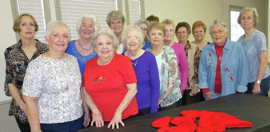 Potpourri Club strives to cultivate friendship and to utilize the talents and energies of club members to assist organizations, families, and /or individuals needing and desirous of help and service. Pictured are members of the group with a few of the 136 hats the ladies have fashioned for the Little Hats, Big Hearts American Heart Association project. Photo: Red Hat Group