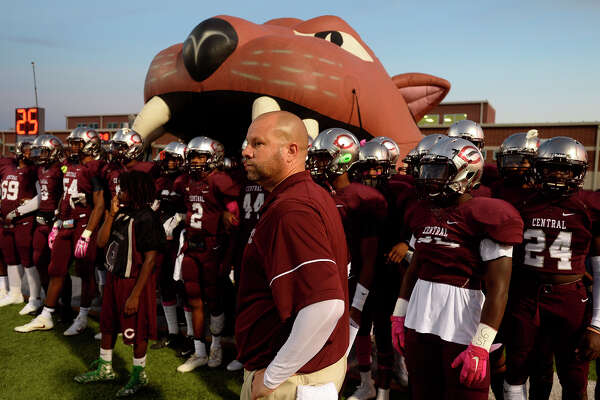 Central head coach Toby Foreman prepares to lead his Jaguars onto the field to take on Lumberton for homecoming at the Thomas Center on Friday night.  Photo taken Friday 10/14/16 Ryan Pelham/The Enterprise