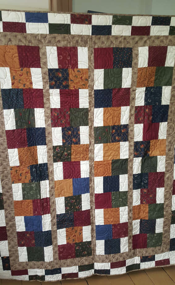This quilt, made and donated by Jen Mercer, is one of the items that will be auctioned off at the dinner and auction to benefit the Stephenson House. Photo: Carol Arnett • Intelligencer