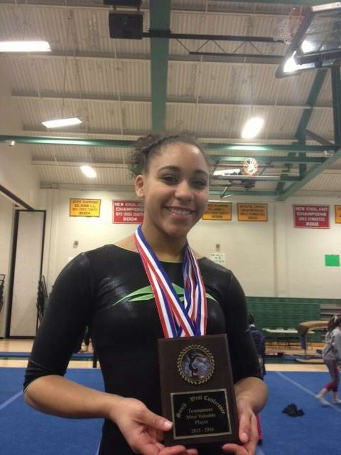New Milford sophomore Mikayla Dumas won the all-around (36.10), the vault (9.30), the bars (9.00) and the floor (9.00) to help the Green Wave win their third straight SWC gymnastics championship on Thursday. Photo: Contributed / Contributed Photo / Jon Chik/Hearst Connecticut Media