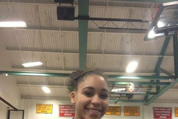 New Milford sophomore Mikayla Dumas won the all-around (36.10), the vault (9.30), the bars (9.00) and the floor (9.00) to help the Green Wave win their third straight SWC gymnastics championship on Thursday.