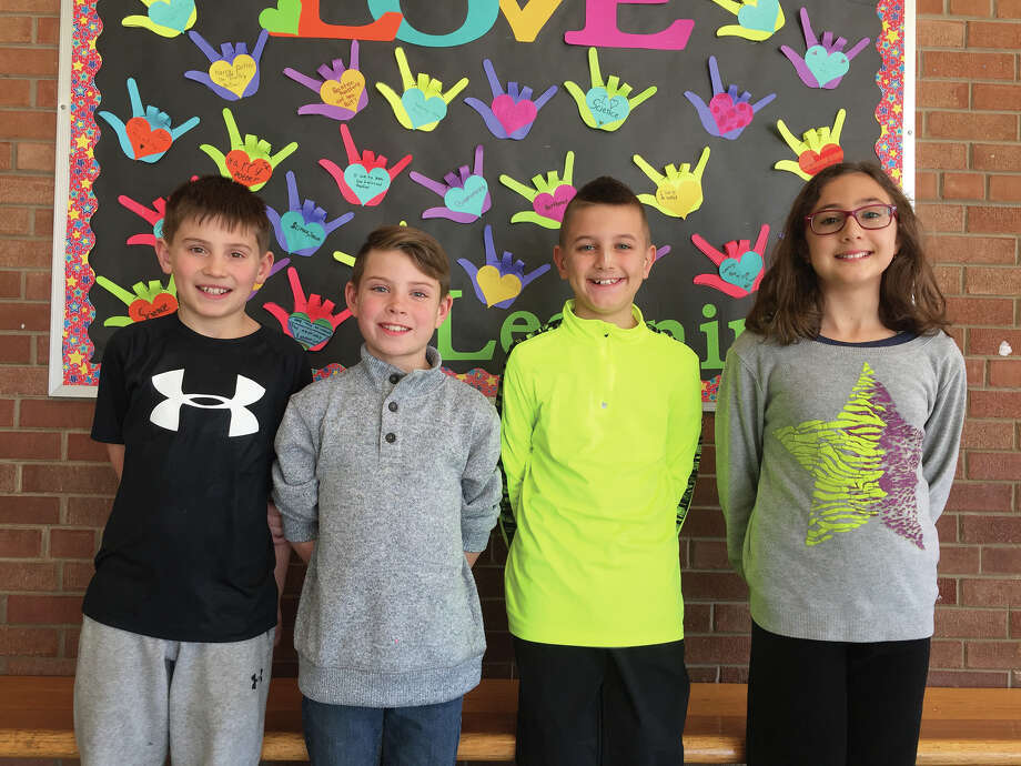 Young Authors Woodland Elementary Young Author Representatives are, from left:  Adam Lugge (Sprinkler the Water Breathing Dragon), Nolan Forinash (Surprise in the Teacher's Lounge), Colin Walsh (Four Scores: A Balls Tale) and Efthalia Ellinas (Dreaming with Stars).  These four students' manuscripts will be judged at Hadley House and one winner will be chosen to represent Woodland Elementary at the state Young Authors competition. Photo: Julia Biggs • Intelligencer