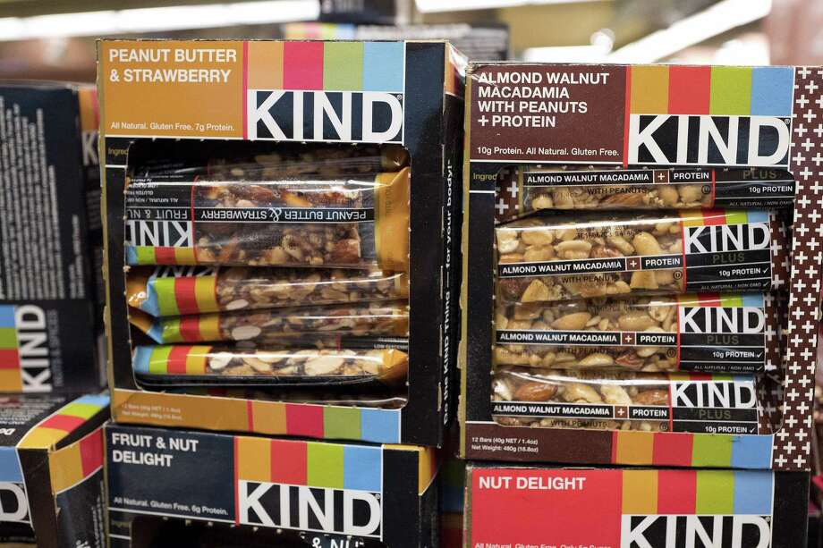 Kind snack bars are displayed in a New York supermarket. Kind CEO's move to create a nonprofit dedicated to revealing and countering the food industry's influence on public health underscores the division between Big Food companies and newer players that market themselves as wholesome alternatives aligned with public health. Photo: Mark Lennihan /Associated Press / Copyright 2017 The Associated Press. All rights reserved.