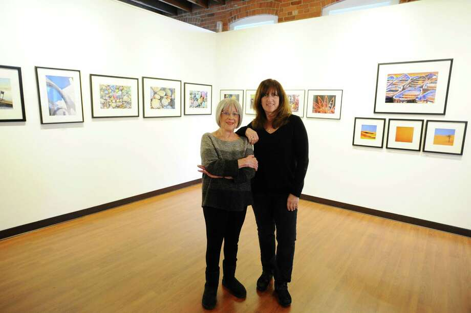 "Stamford photographers Phyllis Sinrich, left, and Deborah Loeb Bohren will share their travel photography exhibit, ""Wanderlust,"" inside the Loft Artists Association on Pacific Street. Photo: Michael Cummo / Hearst Connecticut Media / Stamford Advocate"