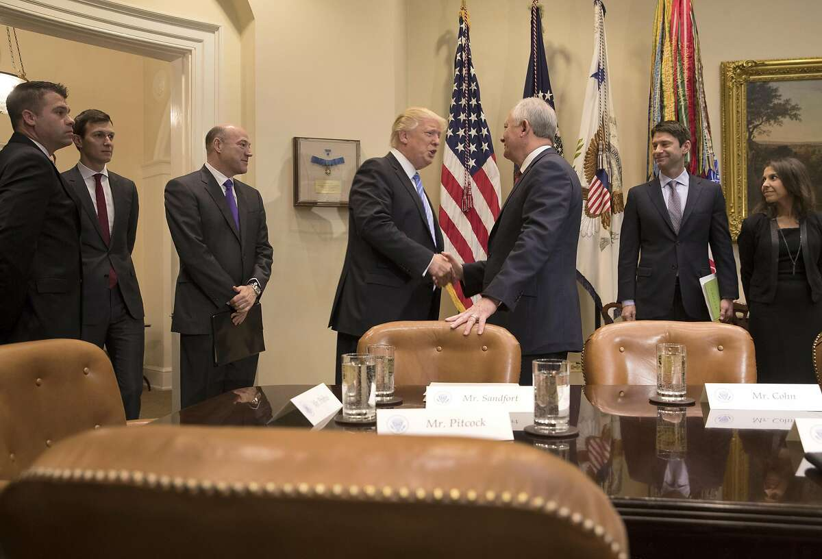 President Donald Trump greets Greg Sandfort, chief executive of Tractor Supply Co., during a meeting with the Retail Industry Leaders Association and member company chief executives in the Roosevelt Room of the White House, in Washington, Feb. 15, 2017. (Stephen Crowley/The New York Times)
