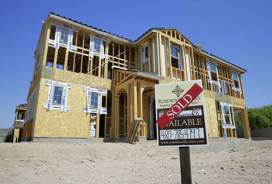 A new home under construction in Phoenix. The National Association of Home Builders/Wells Fargo released its February index of builder sentiment on Wednesday. Photo: Matt York / Associated Press / Copyright 2016 The Associated Press. All rights reserved. This material may not be published, broadcast, rewritten or redistribu
