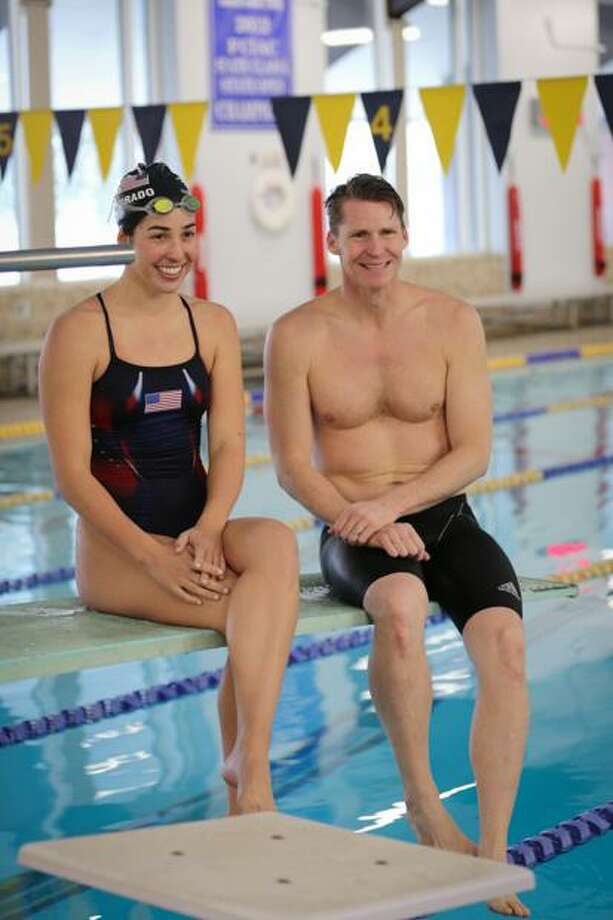 Olympic gold medalists Maya DiRado and Josh Davis pose at the Darien YMCA after giving a clinic to the members on Saturday, Feb. 12. Photo: Franzvideo Productions / Contributed / Darien News contributed