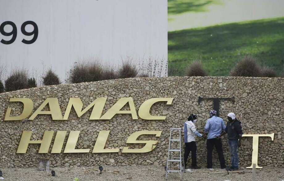 U.S. President Donald Trump's two sons in charge of his business empire will attend a closed-door event to mark the opening of the Trump International Golf Club in Dubai. Photo: Jon Gambrell /Associated Press / Copyright 2017 The Associated Press. All rights reserved.
