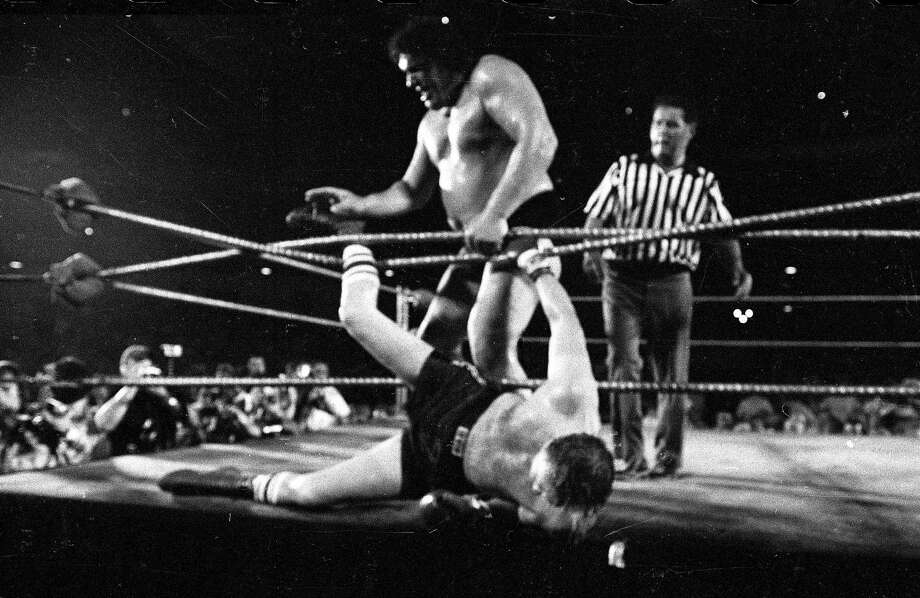 "FILE - In this June 26, 1976, file photo, professional wrestler Andre the Giant tosses heavyweight contender Chuck Wepner out of the ring at Shea Stadium New York. HBO Sports, and the Bill Simmons Media Group will produce ""Andre The Giant,"" a documentary film examining the life and career of one of wrestling's biggest stars. The film will explore Andre's upbringing in France, his celebrated career in WWE and his forays in the entertainment world. (AP Photo/File) Photo: Associated Press / AP1976"