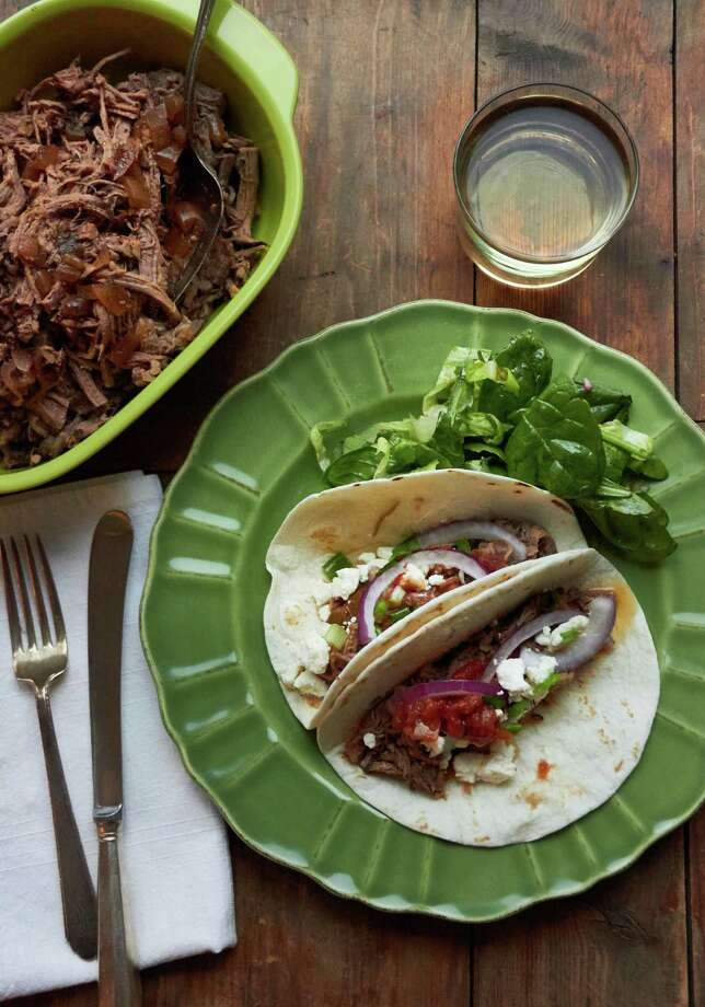 This December 2016 photo shows barbacoa beef tacos in New York. This dish is from a recipe by Katie Workman. (Mia via AP) ORG XMIT: NYKT102 Photo: Mia / Mia/Katie Workman