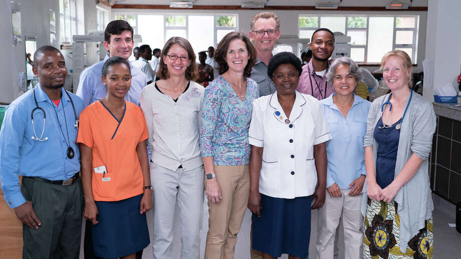 Rice 360°'s Rebecca Richards-Kortum and Maria Oden (fourth and fifth from left, respectively) with doctors, nurses, collaborators and Rice University Provost Marie Lynn Miranda (second from right) and NEST collaborator and Malawi College of Medicine pediatrician Josephine Langton (right) at Queen Elizabeth Central Hospital in Blantyre, Malawi