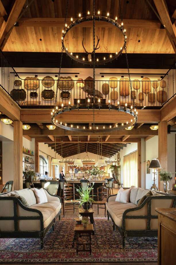 Signature restaurant at La Cantera is located in a Mediterranean style building that was originally the pro shop at The Academy. This entire space was gutted down to the bare bones, and an engineered hexagonal cupola was built. The roof and framing were removed, and new reclaimed timbers were brought in to create an authentic space that is reflective of the exterior architectural form. The cupola is now used as the entry/reception below and a new mezzanine above. Photo: Courtesy Jason Risner / 2016, Jason Risner Photography