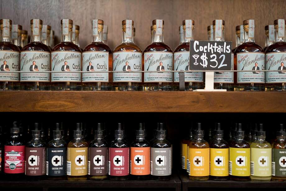 A variety of bitters are available for tasting at the Napa Valley Distillery inside the Oxbow Public Market in Napa. The distillery features the largest selection of bitters in the world. Photo: James Tensuan, Special To The Chronicle