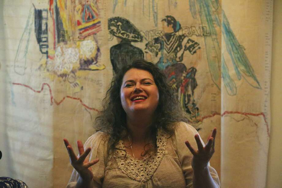 "Artist Laurel Gibson talks about her art work in the dining room of her home. Gibson creates images on old piano rolls. The piece behind her titled ""Watching Over Us"" and depicts the theme of the Old Spanish Trail. Gibson's work will be a part of the On & Off Fredericksburg Road Studio Tour Saturday and Sunday. Photo: John Davenport /San Antonio Express-News / ©San Antonio Express-News/John Davenport"