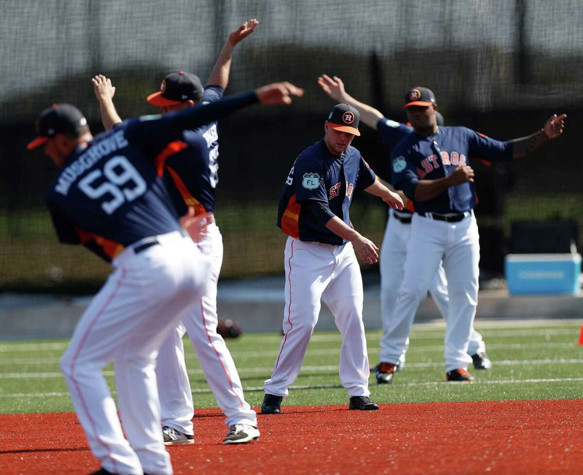 Astros pitchers and catchers stretch as they held their first workout of spring training at The Ballpark of the Palm Beaches, in West Palm Beach, Florida, Tuesday, February 14, 2017.
