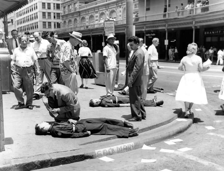 Civil defense drill at Main and Texas Avenue, June 14, 1954.    No, these youths aren't really injured. They are acting out a scenario of what would happen if an atomic bomb was detonated thousands of feet above the intersection of Capitol at Austin at 11:40 a.m.     Civil defense officials told the Chronicle that 164,000 people would have been killed immediately. Another 90,000 would have been injured by radiation exposure, flash burns and the bomb blast.     A B-47 from Barksdale Air Force base simulated the attack that Monday morning.