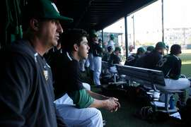 Center fielder Bradley Zimmer watches the game next to head coach Nino Giarratano, left, during a game against UC Santa Barbara at Dante Benedetti Diamond at Max Ulrich Field May 16, 2014 in San Francisco, Calif.