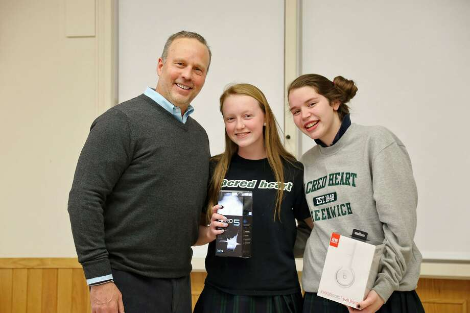 Sacred Heart Greenwich broadcast essay winners with documentary producer Andrew Freirich are, left to right, Georgia Ferguson of Old Greenwich and Kathleen Murray of Wilton. Photo: Contributed