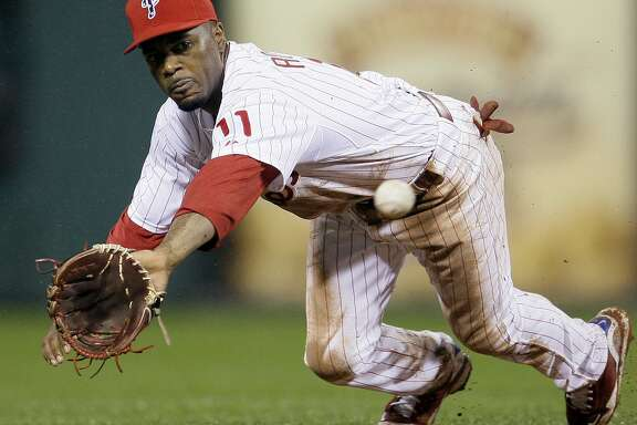 Philadelphia Phillies shortstop Jimmy Rollins dives for a line drive-out by New York Mets' Nelson Figueroa in the fifth inning of a baseball game, Friday, Sept. 11, 2009, in Philadelphia. Philadelphia won 4-2. (AP Photo/Matt Slocum)