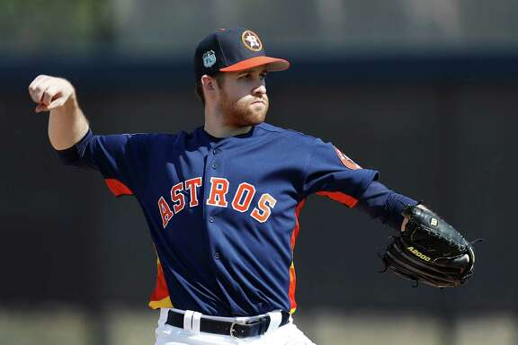 Houston Astros starting pitcher Collin McHugh works a drill as the Astros pitchers and catchers held their first workout of spring training at The Ballpark of the Palm Beaches, in West Palm Beach, Florida, Tuesday, February 14, 2017.