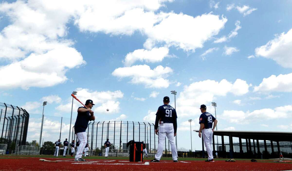 Coaches conduct drills on the agility field as the Astros pitchers and catchers held their first workout of spring training at The Ballpark of the Palm Beaches, in West Palm Beach, Florida, Tuesday, February 14, 2017.