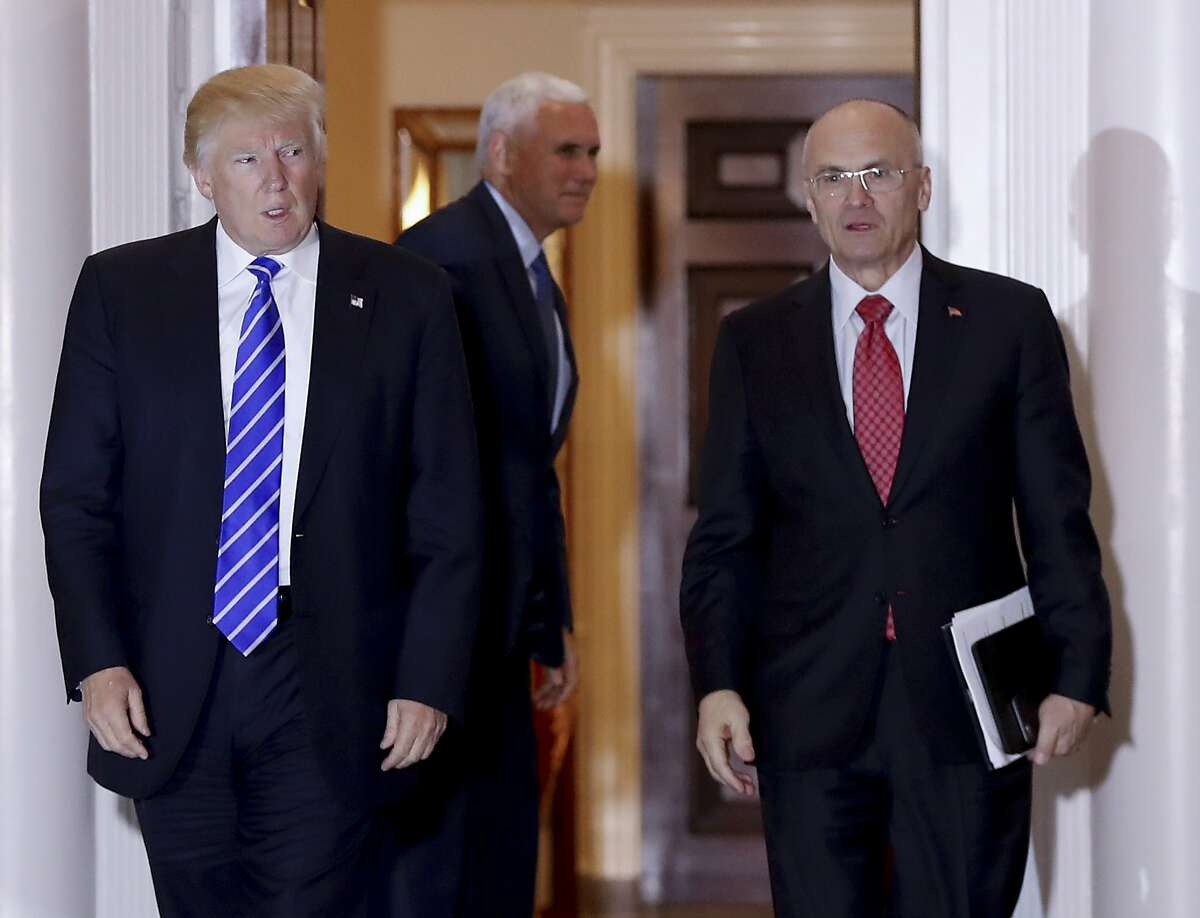FILE - In this Nov. 19, 2016 file photo, then-President-elect Donald Trump walks Labor Secretary-designate Andy Puzder from Trump National Golf Club Bedminster clubhouse in Bedminster, N.J. Puzder�s nomination appeared to be in serious trouble Wednesday, Feb. 15, 2017, as Republicans said they were concerned over his failure to pay taxes for five years on a former housekeeper who wasn�t authorized to work in the U.S. (AP Photo/Carolyn Kaster, File)