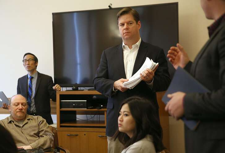 Former San Francisco supervisor Eric Mar (left) and San Francisco supervisor Mark Farrell (right) hold a community group meeting to discuss getting the city of San Francisco full access to high speed internet at city hall on Tuesday, February 14, 2017, in San Francisco, Calif.