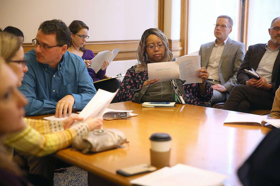 Roslyn Bell from Hunters Point Family looks through a survey at a community group meeting to discuss getting the entire city of San Francisco access to high speed internet at city hall on Tuesday, February 14, 2017, in San Francisco, Calif.