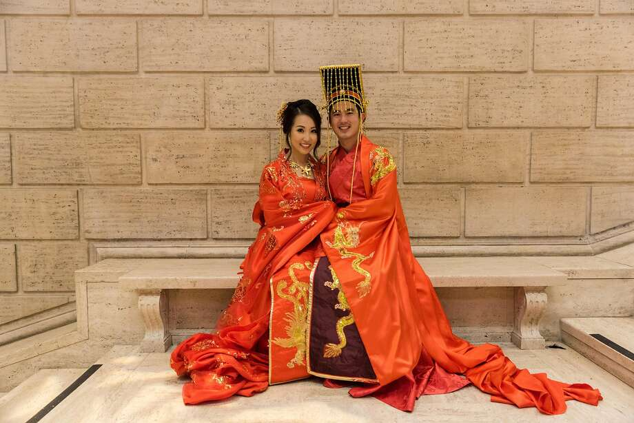 "Chris Chuang and Claudia Lam married on Nov. 5, 2016, at the Asian Art Museum. ""Somehow I came up with the idea that we should have an ancient imperial Chinese wedding,"" Chris said. These ""Hanfu"" outfits were custom-made in China for the couple. His had a dragon, hers had a phoenix. Photo: The Film Squad"