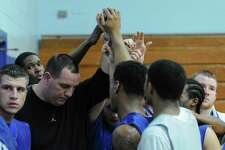 Bishop Maginn boys basketball coach Rich Gilooly, third from left, gathers with his team after practice at the school on Monday Feb. 13, 2012 in Albany, NY.  (Philip Kamrass / Times Union )
