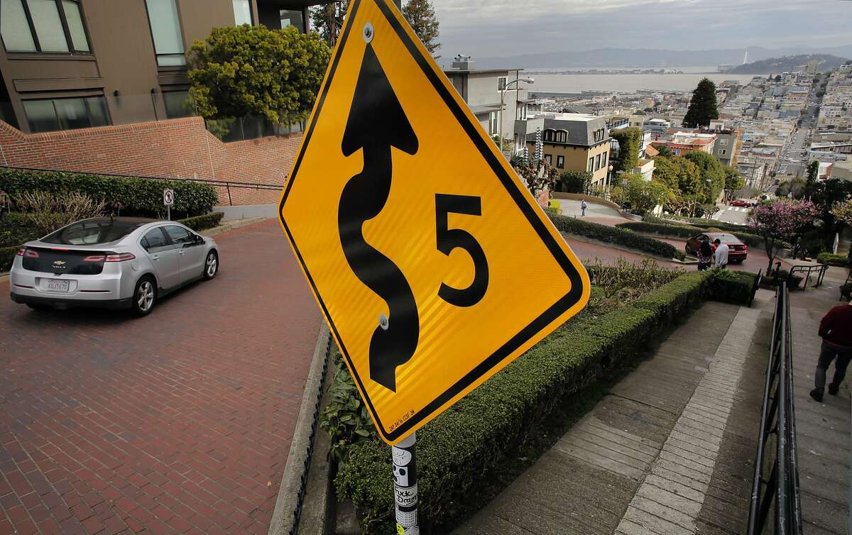 Vehicles twist their way down Lombard Street on Feb. 15, 2017, in San Francisco. San Francisco Supervisor Mark Farrell wants to charge a toll to drive down the famed roadway.