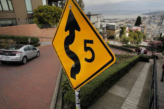 Vehicles twist their way down Lombard St. on Wednesday Feb. 15, 2017, in San Francisco, Ca. San Francisco Supervisor Mark Farrell wants to charge a toll to drive down the famed roadway.