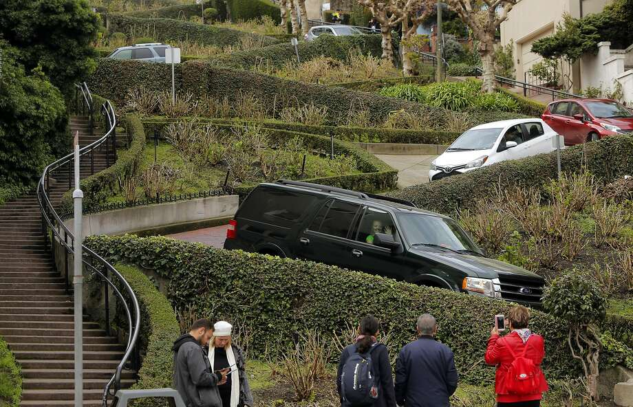Vehicles twist their way down Lombard St. on Wednesday Feb. 15, 2017, in San Francisco, Ca. San Francisco Supervisor Mark Farrell wants to charge a toll to drive down the famed roadway. Photo: Michael Macor, The Chronicle