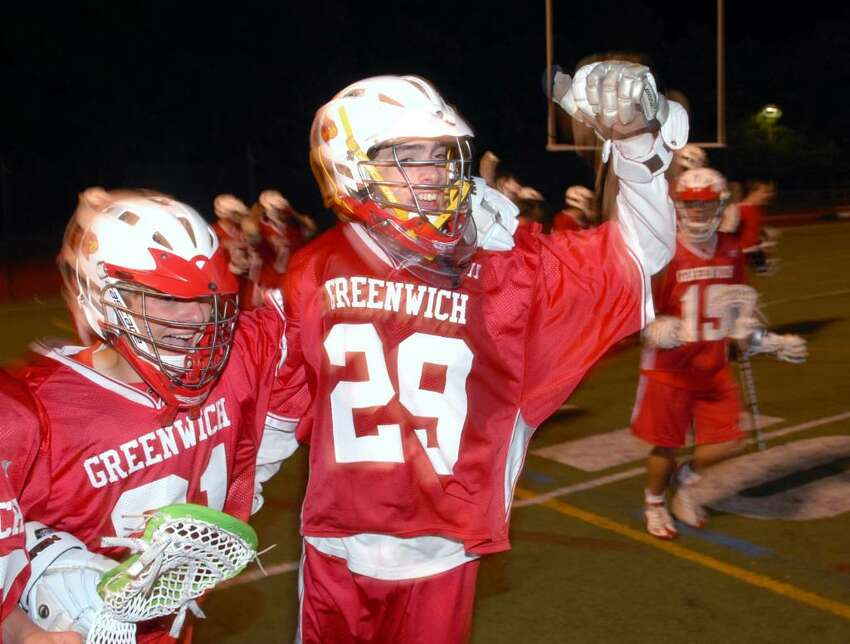 Daniel Feeney, #29, the goalie for Greenwich High School and the MVP of the FCIAC Lacrosse Championship, celebrates a 5-4 victory over New Canaan High School, at Brien McMahon High School in Norwalk, Friday evening, May 28, 2010.