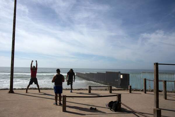 People work out near the Mexico - US border at Playas de Tijuana in northwestern Mexico on February 13, 2017. Attention Editors: This image is part of an ongoing AFP photo project documenting the life on the two sides of the Mexico/US border simultaneously by two photographers traveling for ten days from California to Texas on the US side and from Baja California to Tamaulipas on the Mexican side between February 13 and 22, 2017. You can find all the images with the keyword: BORDERPROJECT2017 on our wire and on www.afpforum.com / AFP / GUILLERMO ARIAS        (Photo credit should read GUILLERMO ARIAS/AFP/Getty Images)