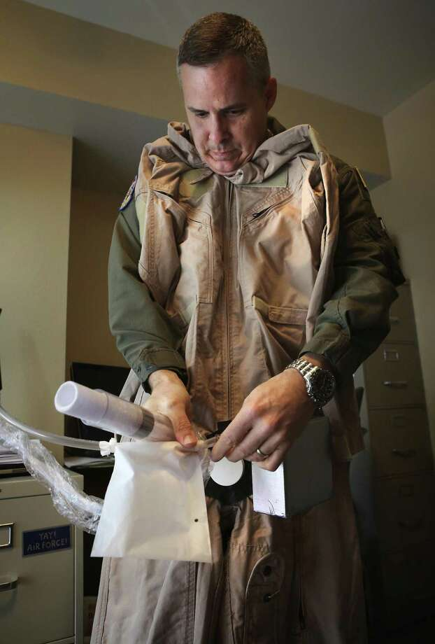 Col. Dr. Thatcher Cardon, inventor of a new adaptable hygiene spacesuit system, illustrates how the suit works, for either men or women, on Wednesday, Feb. 15, 2017. Photo: Bob Owen, Staff / San Antonio Express-News / ©2017 San Antonio Express-News