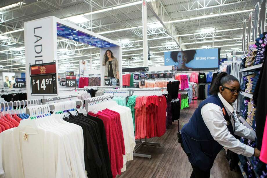 Sheree Roebuck straightens clothes in the womens' section at the new Wal-Mart on Wednesday, Feb. 15, 2017, in Tomball. Photo: Brett Coomer, Houston Chronicle / © 2017 Houston Chronicle