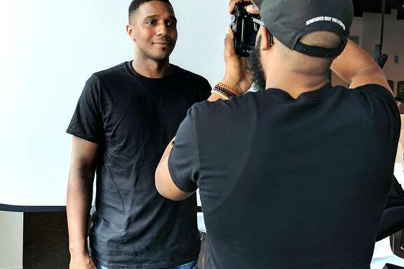 Bryon Summer takes a photograph of Kourtni Marshall, a software engineer at Google, as part of Summer's nationwide project to show 1,000 images of black men in various occupations.