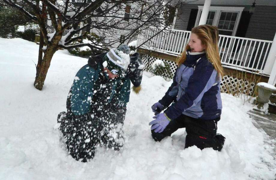 Westport 10-year-old old Chloe D'Angelis scores a direct hit with a snowball on her brother A.J., 13, during a snowball fight in front of their house Feb. 12. A wintry mix of snow, rain and freezing rain fell through the area making a mess for some but more fun in the snow for others. Photo: Alex Von Kleydorff / Hearst Connecticut Media / Connecticut Post