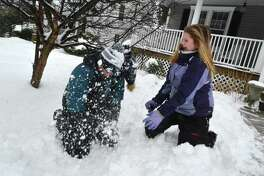 Westport 10-year-old old Chloe D'Angelis scores a direct hit with a snowball on her brother A.J., 13, during a snowball fight in front of their house Feb. 12. A wintry mix of snow, rain and freezing rain fell through the area making a mess for some but more fun in the snow for others.
