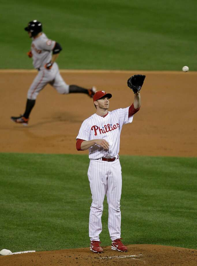 Cody Ross (left) rounds the bases after hitting one of his two homers off Philadelphia's Roy Halladay in the 2010 NLCS. Photo: Rob Carr, AP