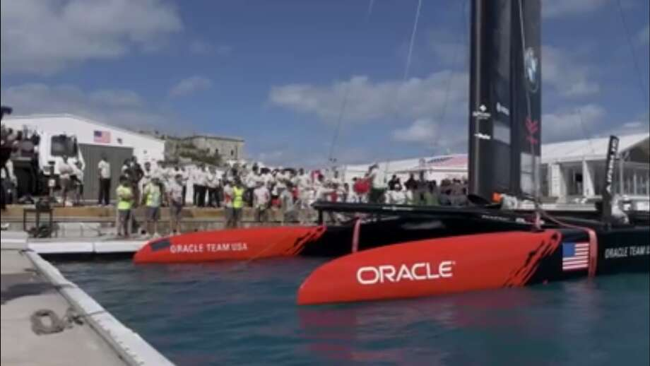 Oracle unveils its AC50 America's Cup foiling catamaran, seen here in a screen shot from the Facebook Video event. (Courtesy Oracle Team USA)